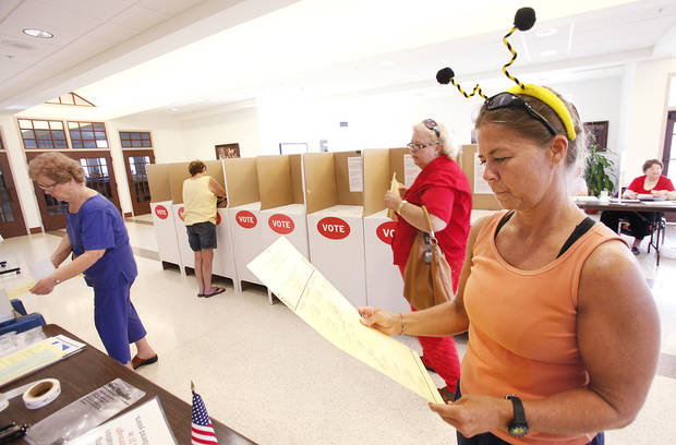 Andrea Carpenter, dressed as a bee for vacation bible school, looks over a sample ballot at Holy Trinity Lutheran Church in Edmond, Tuesday, July 27, 2010. Carpenter votes at Saint Monica.   Photo by David McDaniel, The Oklahoman
