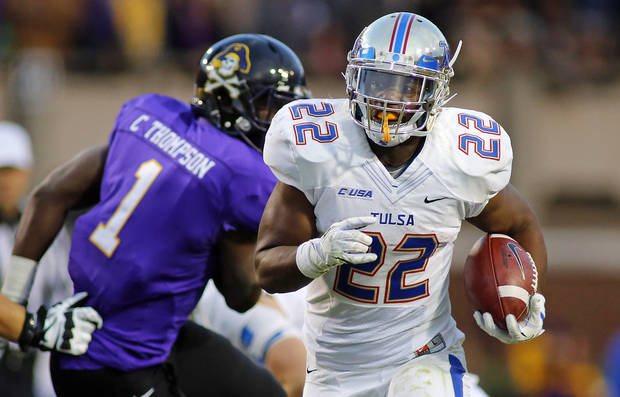 Tulsa's Trey Watts (22) breaks away from East Carolina's Chip Thompson (1) for a gain during the first half of an NCAA college football game in Greenville, N.C., Saturday, Nov. 9, 2013. (AP Photo/Karl B DeBlaker)