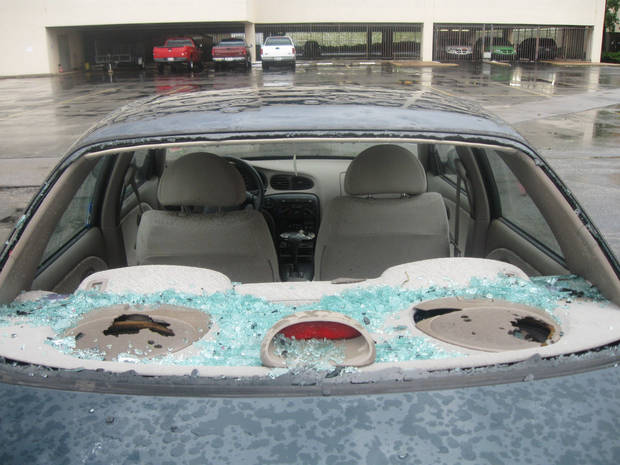 My car after the hail storm. At least tennis wasn't played Sunday, huh? Monday was a great day of 6A finals.
