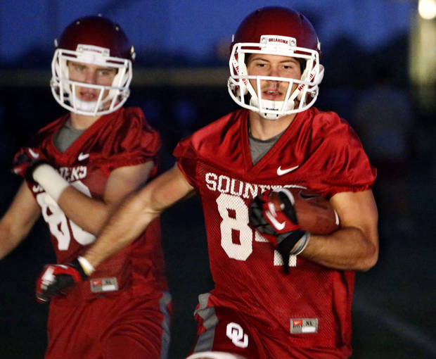 Receivers Don Caudill (84), right, and Taylor McNamara (88) participate in ball handling drills at pre-dawn practice for the University of Oklahoma Sooners (OU) in Norman, Okla., Friday, Aug. 2, 2013. Photo by Steve Sisney, The Oklahoman