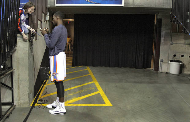 Oklahoma City Thunder's Jeff Green signs an autograph for Leah Housley, of Tulsa, before the start of the preseason NBA basketball game between the Oklahoma City Thunder and the Memphis Grizzlies on Tuesday, Oct. 12, 2010, in Tulsa, Okla.  Photo by Chris Landsberger, The Oklahoman
