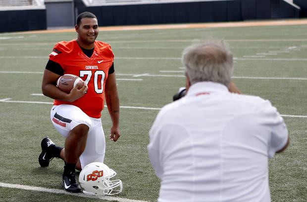 When Jonathan Rush, left, received a medical hardship waiver to play in 2012, it gave the Cowboys a lineman with experience, something OSU desperately needed. Photo by Sarah Phipps, The Oklahoman