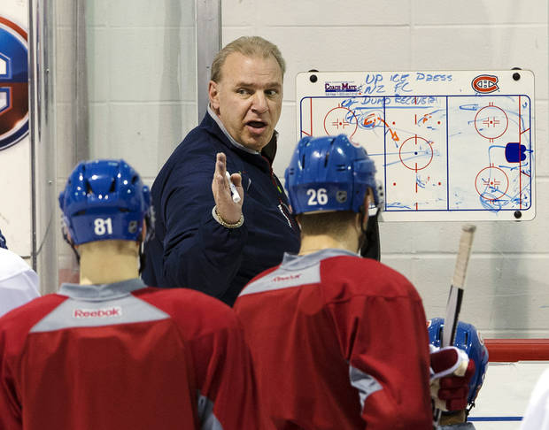 Montreal Canadiens head coach Michel Therrien goes over a play during NHL hockey practice, Monday, April 29, 2013, in Brossard, Quebec. Montreal is scheduled to play the Ottawa Senators in the first round of the Stanley Cup playoffs starting with Game 1 on Thursday. (AP Photo/The Canadian Press, Ryan Remiorz)