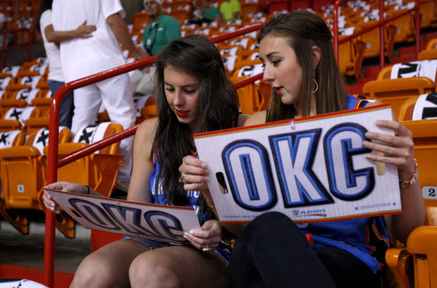 Sisters Sarah Rainbolt, left, and Katherine Rainbolt of Oklahoma City wait for the start of Game 5 of the NBA Finals between the Oklahoma City Thunder and the Miami Heat at American Airlines Arena, Thursday, June 21, 2012. Photo by Bryan Terry, The Oklahoman