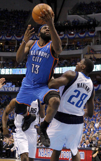 Oklahoma City's James Harden (13) goes past Ian Mahinmi (28) of Dallas  during game 2 of the Western Conference Finals in the NBA basketball playoffs between the Dallas Mavericks and the Oklahoma City Thunder at American Airlines Center in Dallas, Thursday, May 19, 2011. Photo by Bryan Terry, The Oklahoman