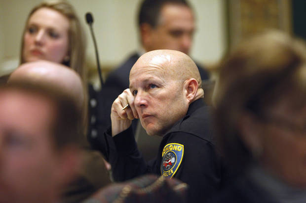 Capt. Tim Dorsey, Edmond police department, listens to a speaker make recommendations to the panel. The Oklahoma Commission on School Security convened for the first time Tuesday afternoon, Jan. 22, 2013, at the state Capitol.  Lt. Gov. Todd Lamb and Senate Pro-tempore Brian Bingman chaired the committee. Photo by Jim Beckel, The Oklahoman