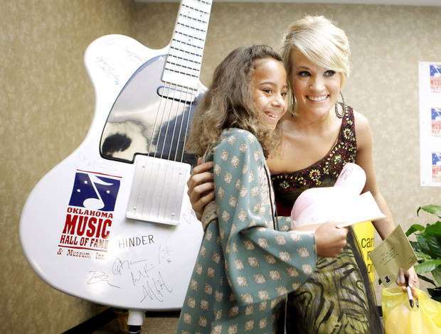 Carrie Underwood poses for a photo with Kiarra Smith, 10, of Okmulgee after a news conference Thursday for Underwood's induction into Oklahoma Music Hall of Fame in Muskogee. PHOTOs BY BRYAN TERRY, THE OKLAHOMAN