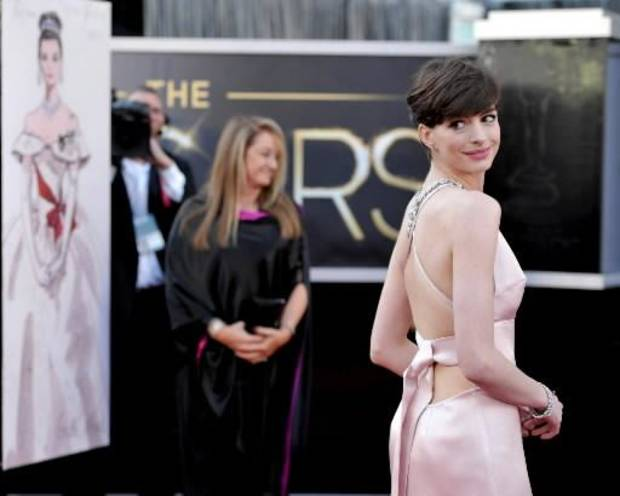 Anne Hathaway shows off the back of her Prada gown. (AP)