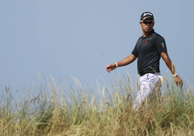Hideki Matsuyama of Japan walks to the 5th tee box during the third round of the British Open Golf Championship at Muirfield, Scotland, Saturday July 20, 2013. (AP Photo/Peter Morrison)