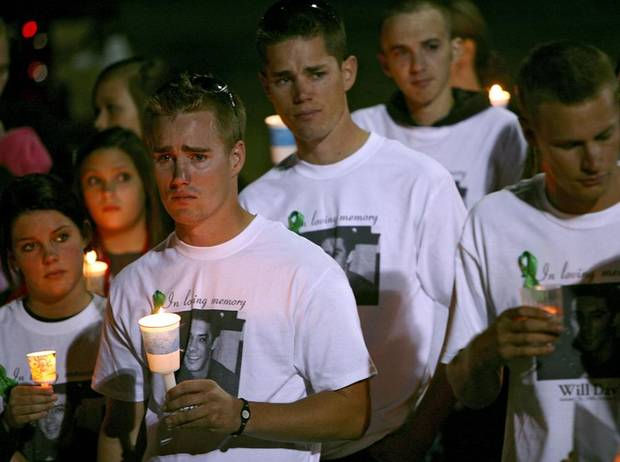 Andy Trent, (at left) join friends and family during a candlelight vigil for William Davis at Mathis Skate Park in Edmond on Tuesday, Oct. 12, 2010. Davis was killed in a motorcycle accident on Oct. 9, 2010. Photo by John Clanton, The Oklahoman
