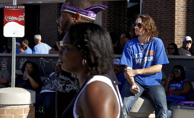Thunder fan Kollin Sendall sits outside the Oklahoma City Arena before game 3 of the Western Conference Finals of the NBA basketball playoffs between the Dallas Mavericks and the Oklahoma City Thunder at the OKC Arena in downtown Oklahoma City, Saturday, May 21, 2011. Photo by Chris Landsberger, The Oklahoman 