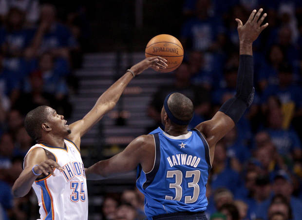 Oklahoma City's Kevin Durant (35) defends against Dallas' Brendan Haywood (33) during game one of the first round in the NBA playoffs between the Oklahoma City Thunder and the Dallas Mavericks at Chesapeake Energy Arena in Oklahoma City, Saturday, April 28, 2012. Photo by Sarah Phipps, The Oklahoman
