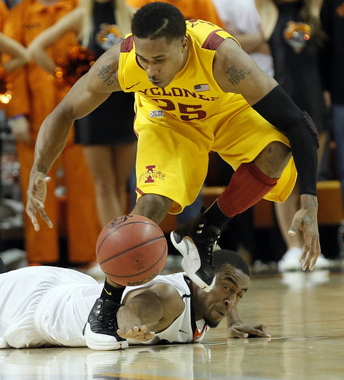 Oklahoma State Cowboys&#039; Markel Brown (22) fights for a loose ball with Iowa State Cyclones&#039; Tyrus McGee (25) during the college basketball game between the Oklahoma State University Cowboys (OSU) and the Iowa State University Cyclones (ISU) at Gallagher-Iba Arena on Wednesday, Jan. 30, 2013, in Stillwater, Okla.  Photo by Chris Landsberger, The Oklahoman