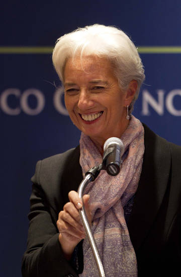 Christine Lagarde, the managing director of the International Monetary Fund, smiles during a news conference at a meeting of Group of 20 finance ministers and central bank governors in Mexico City, Monday, Nov. 5 2012. Finance officials from the world's largest economies on Monday called on countries to reject protectionism and currency manipulation despite a raft of economic problems that include the U.S. deficit. (AP Photo/Eduardo Verdugo)