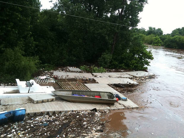 The Chesapeake Boat House dock as it appeared after it was dislodged during Monday's storm. It came to rest near NE 36 on the other side of the Oklahoma River dam. Photo provided