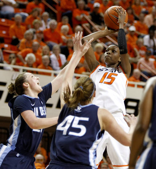 Oklahoma State's Toni Young (15) shoots the ball over San Diego's Klara Wischer (21) and Kameron Knutson (45) during the women's NIT semifinal college basketball game between Oklahoma State University (OSU) and San Diego at Gallagher-Iba Arena in Stillwater, Okla., Wednesday, March 28, 2012. Photo by Bryan Terry, The Oklahoman