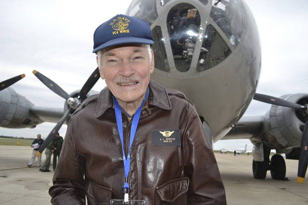 Albert Wheeler, 88, stands in front of the B-29 Superfortress known as FIFI on Saturday. The World War II veteran took a flight in the bomber at Wiley Post Airport in Oklahoma City thanks to the selfless act of a stranger more than 60 years his junior. <strong>Zeke Campfield - Zeke Campfield</strong>