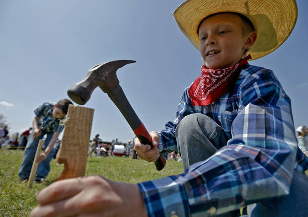 Weston Rutledge drives the stake into the ground to claim land during the Oklahoma Land Run celebration at Mustang Trails Elementary on Monday, April 22, 2013, in Mustang, Okla.   Photo by Chris Landsberger, The Oklahoman