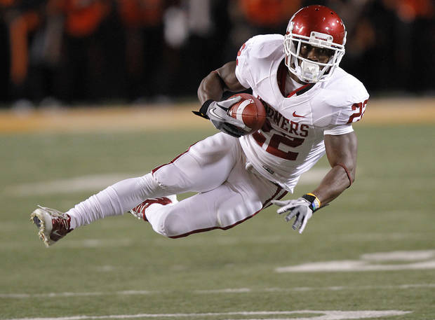 Oklahoma's Roy Finch (22) makes a reception during the Bedlam college football game between the Oklahoma State University Cowboys (OSU) and the University of Oklahoma Sooners (OU) at Boone Pickens Stadium in Stillwater, Okla., Saturday, Dec. 3, 2011. Photo by Chris Landsberger, The Oklahoman