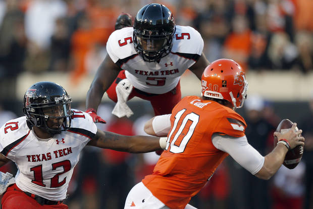 Oklahoma State's Clint Chelf (10) avoids the pressure of Texas Tech's D.J. Johnson (12) and Tre' Porter (5) during a college football game between Oklahoma State University and the Texas Tech University (TTU) at Boone Pickens Stadium in Stillwater, Okla., Saturday, Nov. 17, 2012. Photo by Sarah Phipps, The Oklahoman