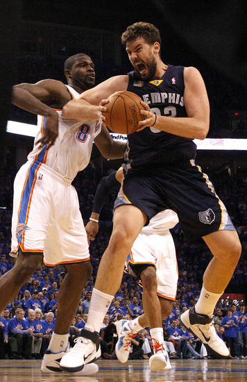 Marc Gasol (33) of Memphis grabs a rebound in front of Oklahoma City's Nazr Mohammed (8) during game 7 of the NBA basketball Western Conference semifinals between the Memphis Grizzlies and the Oklahoma City Thunder at the OKC Arena in Oklahoma City, Sunday, May 15, 2011. Photo by Sarah Phipps, The Oklahoman