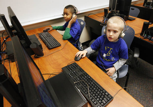 Positive Tomorrows first graders Amiad and Alex use JumpStart on computers at the Oklahoma City University Intergenerational Computer Center. Photo by Paul B. Southerland, The Oklahoman <strong>PAUL B. SOUTHERLAND - PAUL B. SOUTHERLAND</strong>