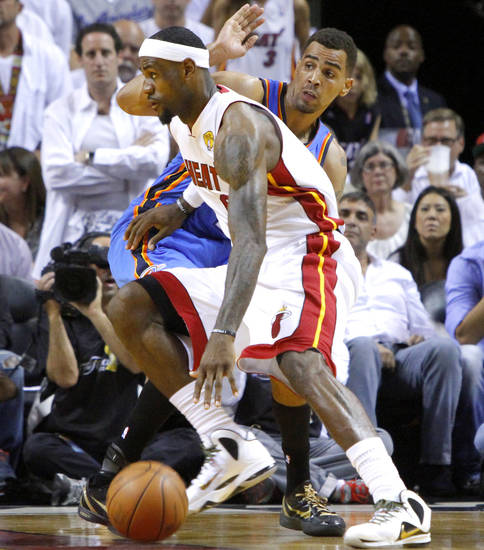Miami's LeBron James (6) goes past Oklahoma City's Thabo Sefolosha (2) during Game 4 of the NBA Finals between the Oklahoma City Thunder and the Miami Heat at American Airlines Arena, Tuesday, June 19, 2012. Photo by Bryan Terry, The Oklahoman