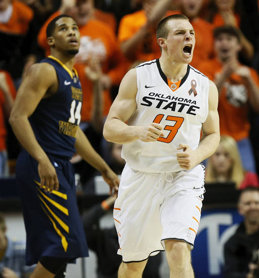 Oklahoma State&#039;s Phil Forte (13) reacts in front of West Virginia&#039;s Gary Browne (14) after hitting a 3-point shot during an NCAA men&#039;s basketball game between Oklahoma State University (OSU) and West Virginia at Gallagher-Iba Arena in Stillwater, Okla., Saturday, Jan. 26, 2013. Photo by Nate Billings, The Oklahoman