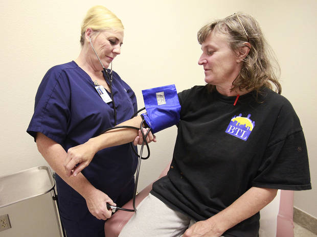 Julie Graves, LPN, takes Beverly Whitaker's blood pressure at the City Rescue Mission, Wednesday, October 12, 2011.  Photo by David McDaniel, The Oklahoman