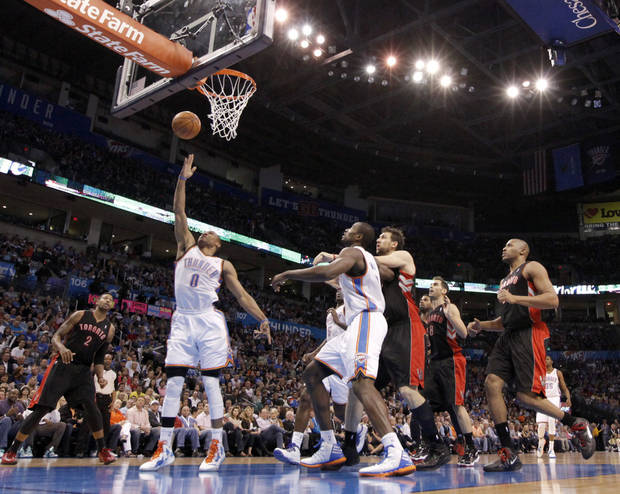 Oklahoma City's Russell Westbrook (0) shoots a lay up during the NBA basketball game between the Oklahoma City Thunder and the Toronto Raptors at Chesapeake Energy Arena in Oklahoma City, Sunday, April 8, 2012. Photo by Sarah Phipps, The Oklahoman.