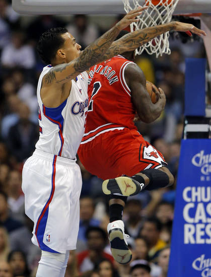 Chicago Bulls' Nate Robinson, right, goes up for a basket past Los Angeles Clippers' Matt Barnes in the first half of an NBA basketball game in Los Angeles, Saturday, Nov. 17, 2012. (AP Photo/Jae C. Hong)