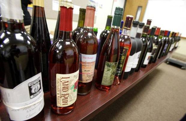 Bottles of wine are lined up to be judged in the wine competition at the Oklahoma State Fair. The second annual Wine Day at the fair will be today. <strong>PAUL B. SOUTHERLAND - THE OKLAHOMAN</strong>