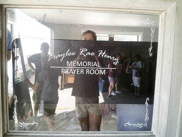 A screen print design is placed on a window in the Jesus House prayer room proclaiming the space as the Braylee Rae Henry Prayer Room. Photo provided <strong></strong>