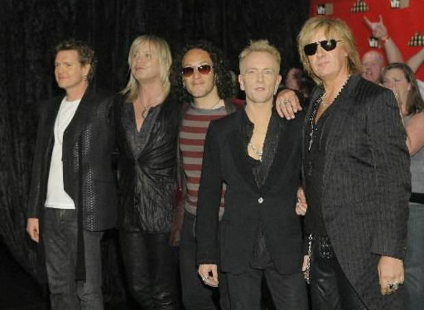 Members of rock group Def Leppard on the red carpet in 2006 during the VH1 Rock Honors concert in Las Vegas. (AP Photo by Jae C. Hong)