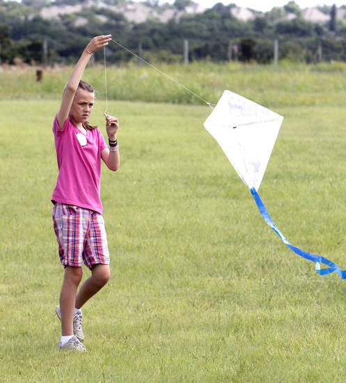 Nine year old Kathrine Tucker flies her kite during LibertyFest's kite festival at Mitch Park in Edmond, OK, Saturday, June 29, 2013,  Photo by Paul Hellstern, The Oklahoman