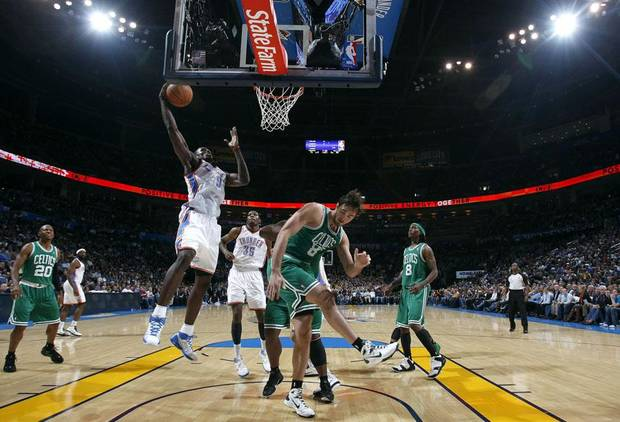 Oklahoma City's Serge Ibaka (9) shoots a layup over Boston's Marquis Daniels (8) during the NBA basketball game between the Oklahoma City Thunder and the Boston Celtics, Sunday, Nov. 7, 2010, at the Oklahoma City Arena. Photo by Sarah Phipps, The Oklahoman ORG XMIT: KOD