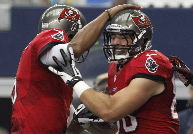 After scoring a touchdown against the Dallas Cowboys, Tampa Bay Buccaneers tight end Luke Stocker (88), left, celebrates with Mike Williams during the first half of an NFL football game on Sunday, Sept. 23, 2012, in Arlington, Texas. (AP Photo/Tony Gutierrez)