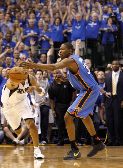 Shawn Marion (0) of Dallas grabs the ball in front of Oklahoma City's Kevin Durant (35) in the final minute of game 5 of the Western Conference Finals in the NBA basketball playoffs between the Dallas Mavericks and the Oklahoma City Thunder at American Airlines Center in Dallas, Wednesday, May 25, 2011. Photo by Bryan Terry, The Oklahoman