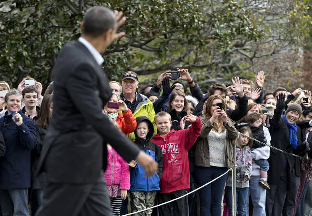 Visitors at the White House in Washington greet President Barack Obama as he walks to board his helicopter for a multi-state campaign blitz, on the last weekend before election day, Saturday, Nov. 3, 2012, in Washington. (AP Photo/J. Scott Applewhite)