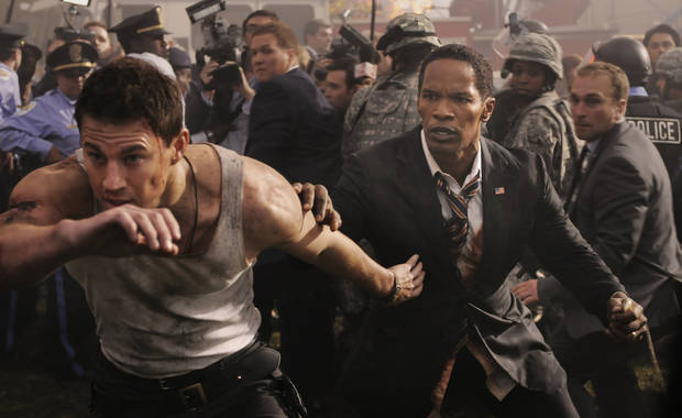 "This film publicity image released by Columbia Pictures shows Jamie Foxx and Channing Tatum, left, in a scene from ""White House Down."" (AP Photo/Sony Columbia Pictures, Reiner Bajo) ORG XMIT: NYET125"