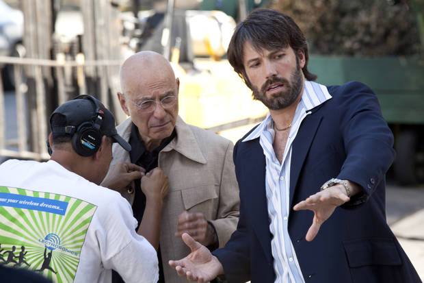 """This image released by Warner Bros shows Alan Arkin, left, and actor-director Ben Affleck on the set of """"Argo.""""  Affleck was nominated Thursday, Dec. 13, 2012 for a Golden Globe for best director for the film. The 70th annual Golden Globe Awards will be held on Jan. 13. (AP Photo/Warner Bros., Claire Folger)  ORG XMIT: NYET740"""