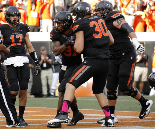 Oklahoma State celebrates a Jeremy Smith (31) touchdown during a college football game between Oklahoma State University (OSU) and Texas Christian University (TCU) at Boone Pickens Stadium in Stillwater, Okla., Saturday, Oct. 27, 2012. Photo by Sarah Phipps, The Oklahoman
