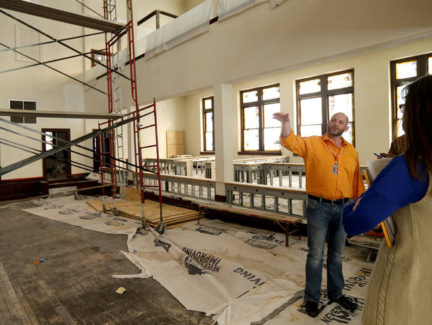 J.W. Peters points to renovations inside the Calvary Baptist Church in the Deep Deuce district of downtown Oklahoma City, Wednesday, Feb. 14, 2013. Photo by Bryan Terry, The Oklahoman