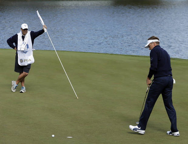 Europe's Ian Poulter reacts after missing a putt and losing the second hole to USA's Webb Simpson during a singles match at the Ryder Cup PGA golf tournament Sunday, Sept. 30, 2012, at the Medinah Country Club in Medinah, Ill. (AP Photo/Charlie Riedel)  ORG XMIT: PGA117