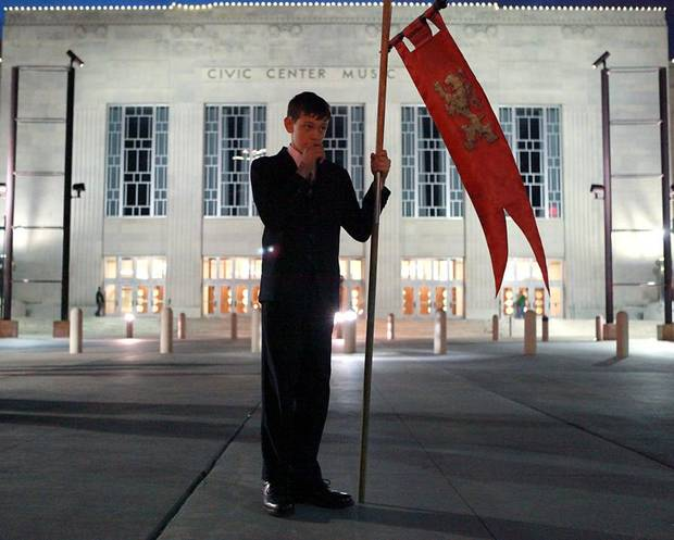 Protestor Anthony Slobodnik, a member of America Needs Fatima, holds a flag outside a satanic demonstration by members of the Church of the IV Princes at the Civic Center Music Hall in downtown Oklahoma City on Thursday, Oct. 21, 2010. Photo by John Clanton, The Oklahoman