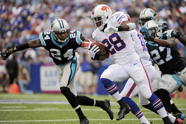 Buffalo Bills running back C.J. Spiller (28) runs the ball against Carolina Panthers cornerback Josh Norman (24) in the second quarter of an NFL football game Sunday, Sept. 15, 2013, in Orchard Park, N.Y. (AP Photo/Gary Wiepert)