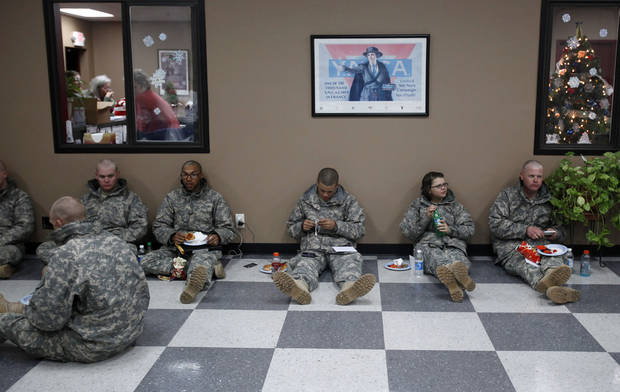 Soldiers from Ft. Sill wait for flights home for the holidays at the YMCA Military Welcome Center at Will Rogers World Airport, Saturday, Dec. 18, 2010, in Oklahoma City. Photo by Sarah Phipps, The Oklahoman
