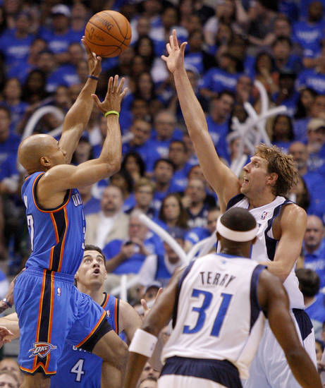 Oklahoma City's Derek Fisher (37) puts up a shot over Dallas' Dirk Nowitzki (41) during Game 3 of the first round in the NBA playoffs between the Oklahoma City Thunder and the Dallas Mavericks at American Airlines Center in Dallas, Thursday, May 3, 2012. Oklahoma City won 95-79. Photo by Bryan Terry, The Oklahoman