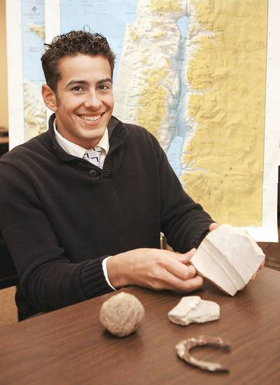 Student Jeremy Cocomise shows some of the artifacts brought back from the dig in Israel.  BY PAUL HELLSTERN,  THE OKLAHOMAN