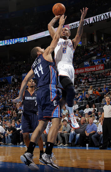 Oklahoma City's Eric Maynor (6) shoots over Charlotte's Jeffery Taylor (44) during the preseason NBA game between the Oklahoma City Thunder and the Charlotte Bobcats at Chesapeake Energy Arena in Oklahoma City, Tuesday, Oct. 16, 2012. Photo by Sarah Phipps, The Oklahoman